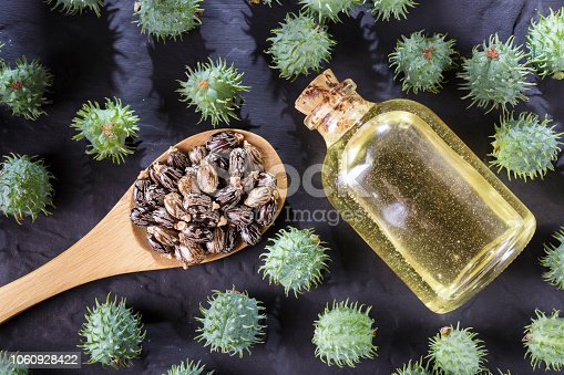 istock beans and castor oil on the black table 1060928422