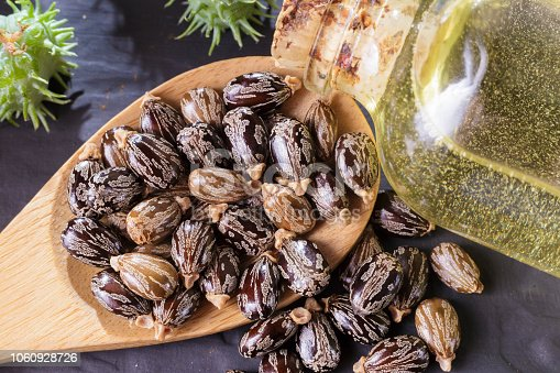 istock beans and castor oil on the black table 1060928726