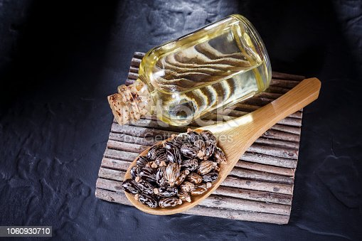 istock beans and castor oil on the black table 1060930710