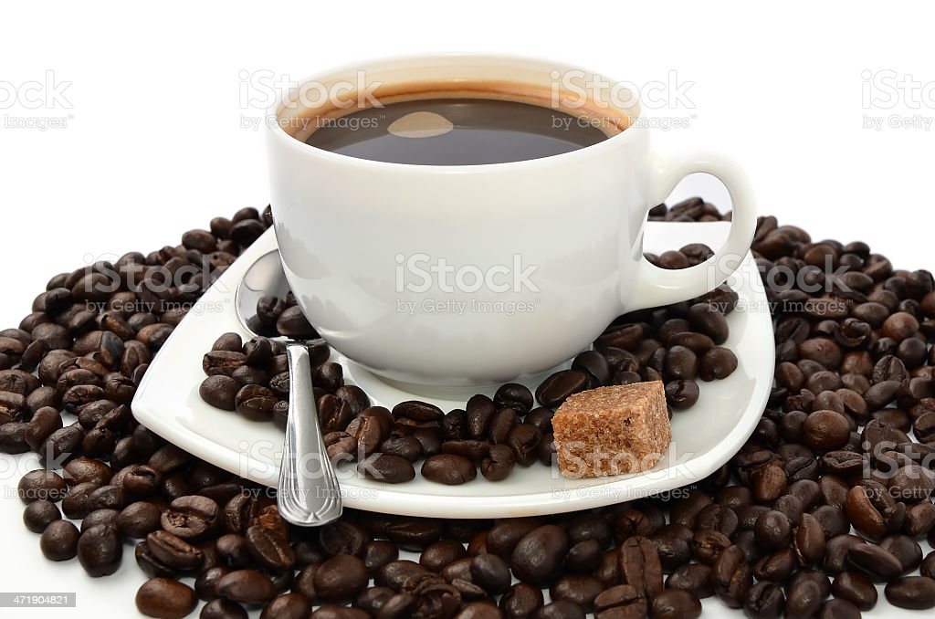 Beans and cup of coffee royalty-free stock photo