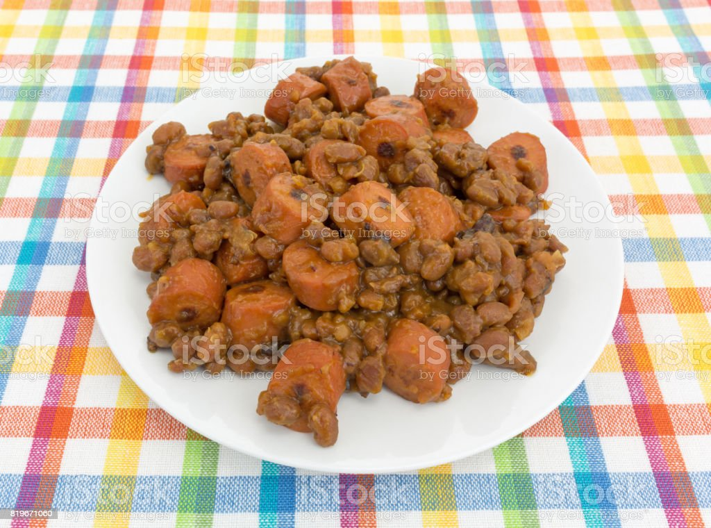 Beans and hot dogs on a plate stock photo