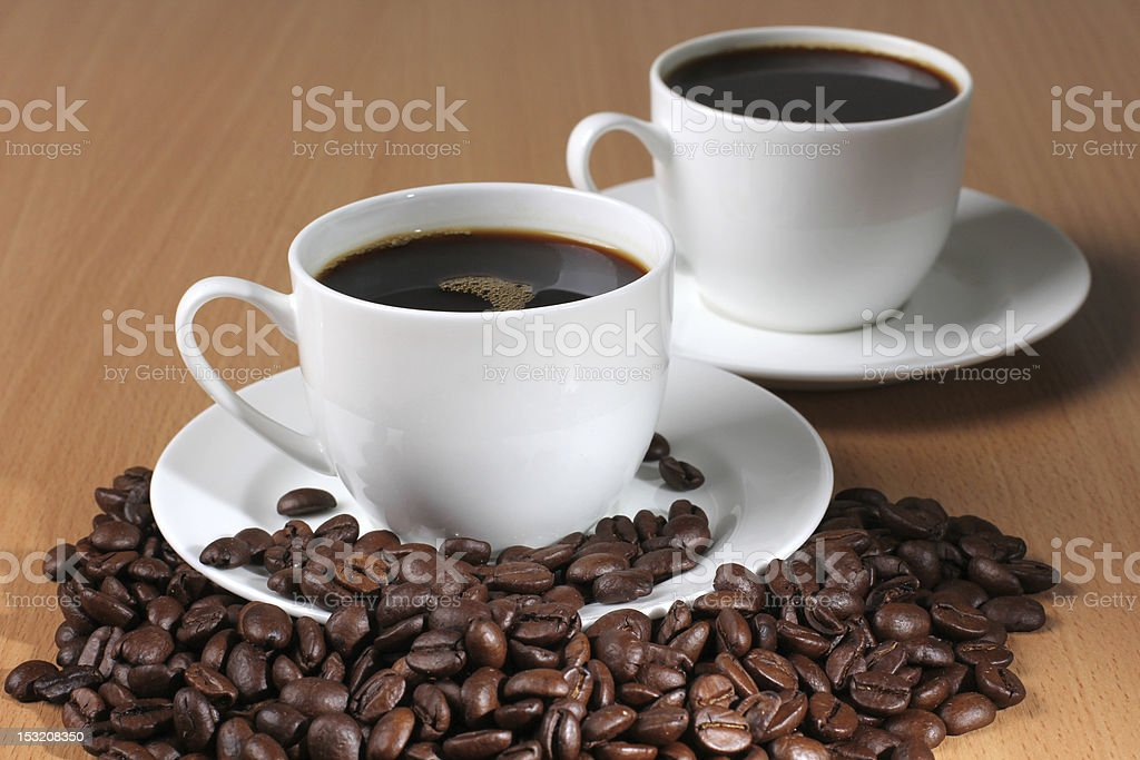 Beans and two white cup royalty-free stock photo