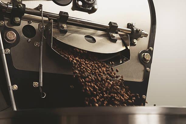 beans freshly baked fall inside roasting machine closeup stock photo