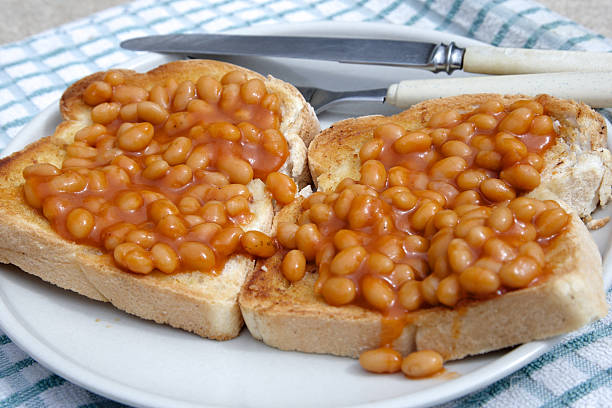 beans on toast - bean stock photos and pictures