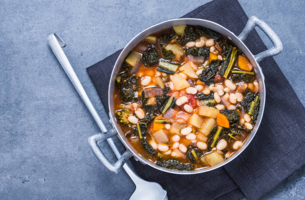 Beans soup with vegetables. Vegetables soup with legumes, vegetables, kale directly above.Traditional tuscany soup, ribollita. stew stock pictures, royalty-free photos & images