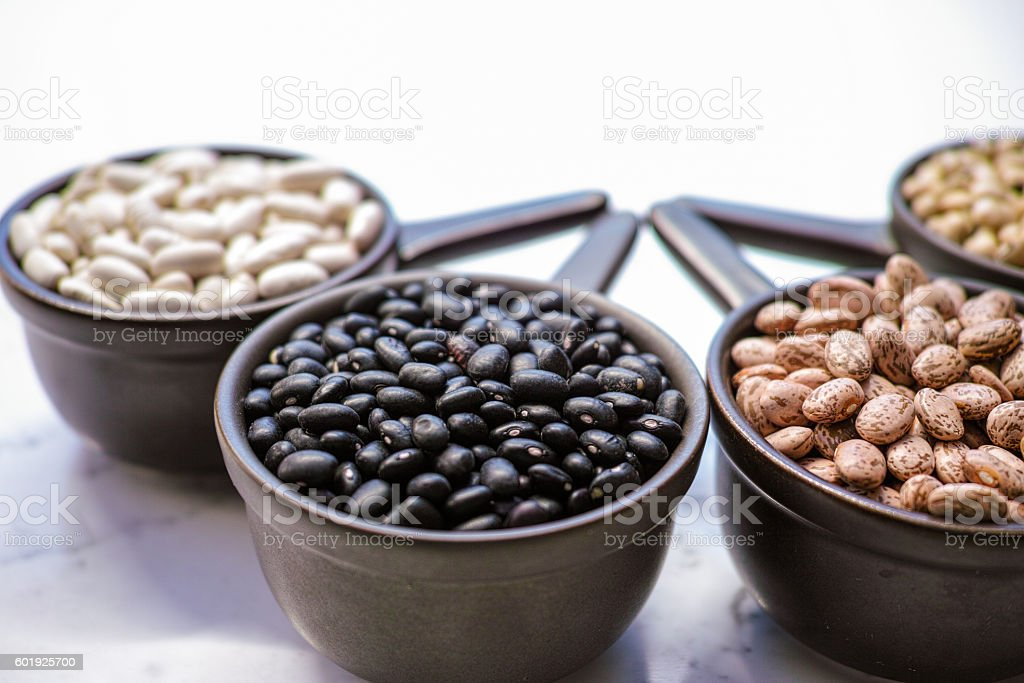 Beans variety/ different types of beans on black wooden backgrou stock photo