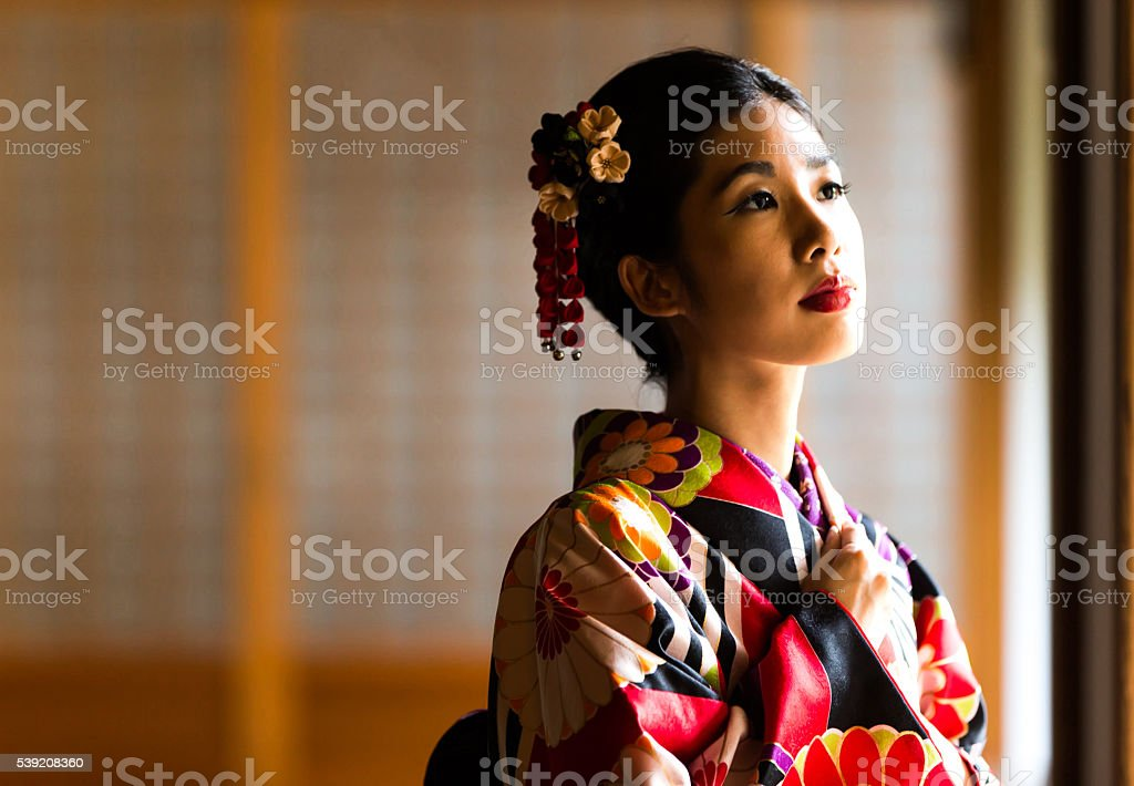 Beantiful Japanese woman at a temple stock photo