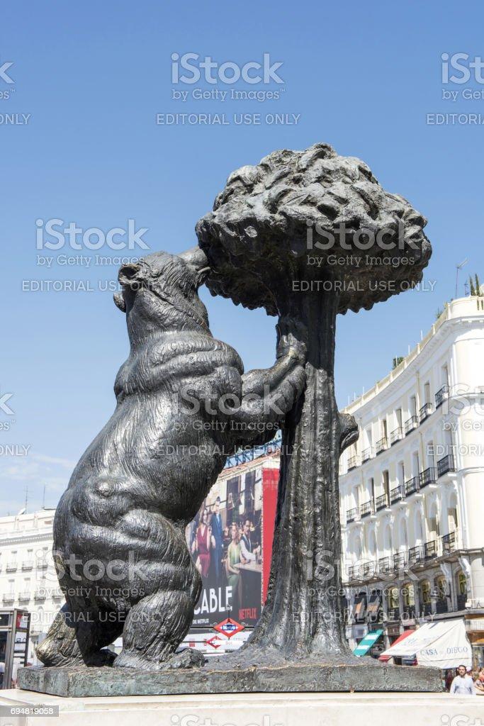 Bear and Madrona Tree in Madrid stock photo