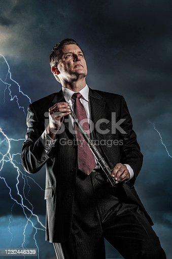 istock Bear Market Businessman in a lighting strom 1232446339