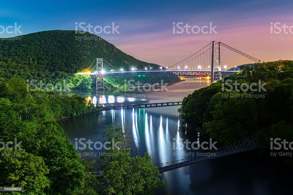 Bear Mountain bridge illuminated by night stock photo
