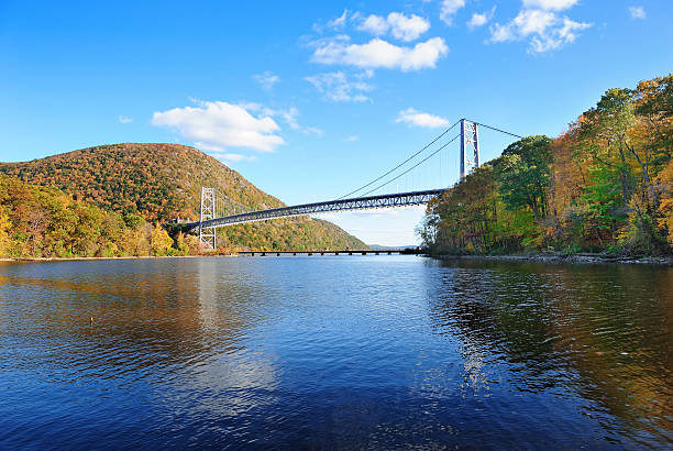 Bear Mountain Bear Mountain with Hudson River and bridge in Autumn with colorful foliage and water reflection. hudson river stock pictures, royalty-free photos & images