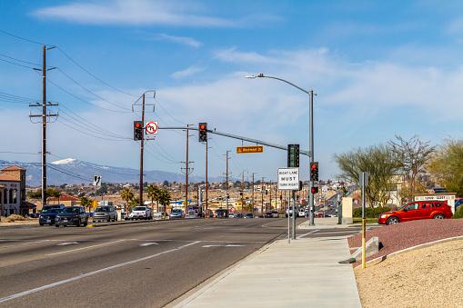 Apple Valley, CA, USA – March 17, 2021: View of the traffic on Bear Valley Road in the Town of Apple Valley in San Bernardino County, California.