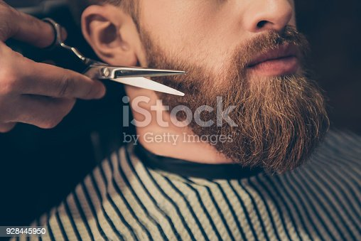 istock Beard styling and cut. Close up cropped photo of a styling of a red beard. So trendy and stylish! Advertising and barber shop concept 928445950