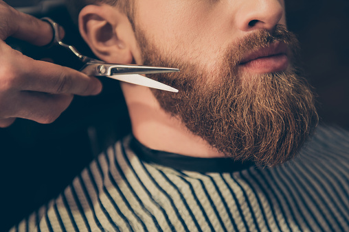986804130 istock photo Beard styling and cut. Close up cropped photo of a styling of a red beard. So trendy and stylish! Advertising and barber shop concept 928445950