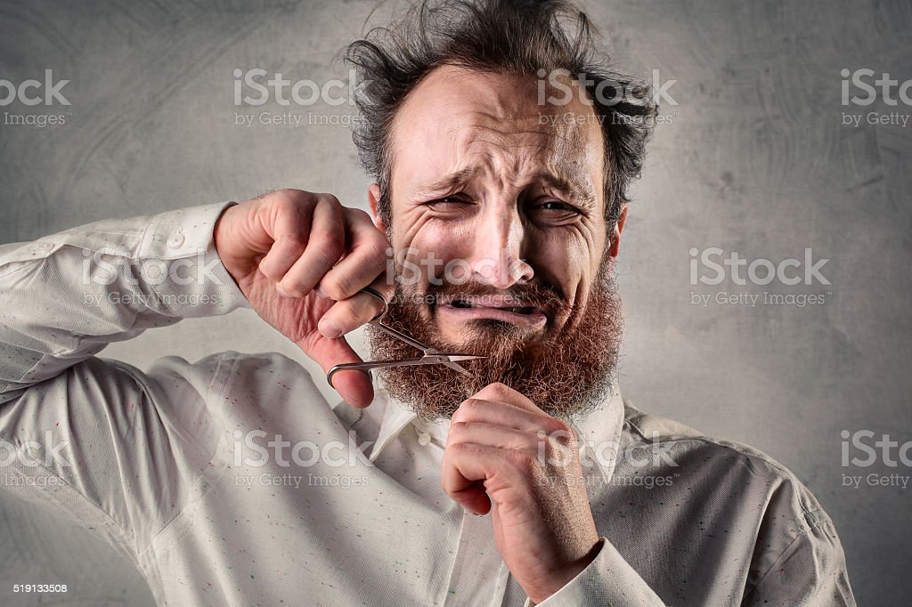 Beard trimming stock photo