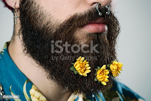 Close-up portrait, Man with a large beard and flowers inside, It's spring in his beard.