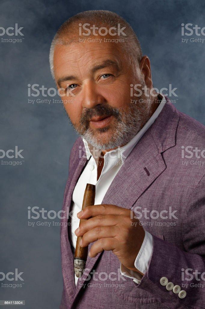 Bearded attitude man holding cuban cigar  Smoking  Individuality portrait royalty-free stock photo