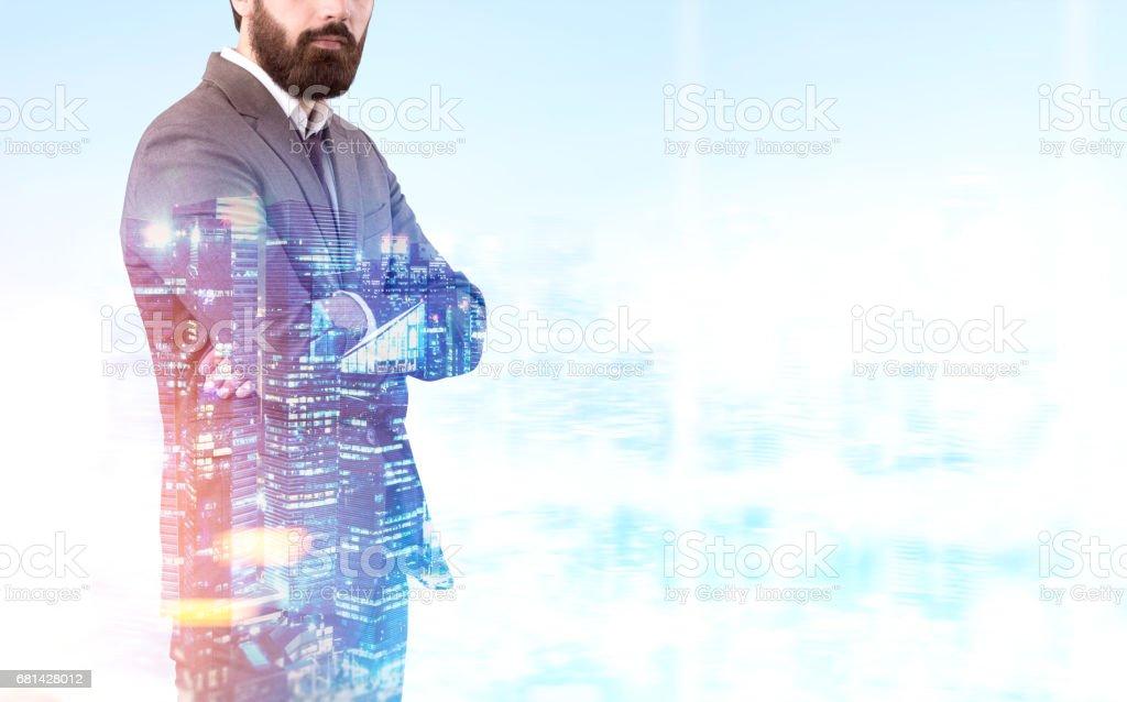 Bearded businessman in night city royalty-free stock photo