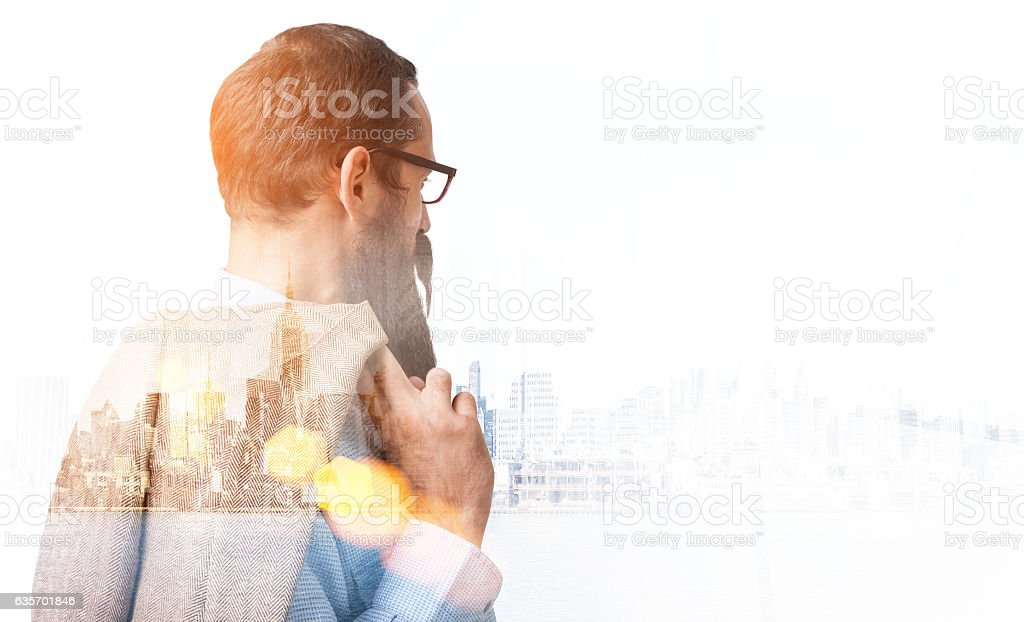 Bearded businessman is enjoying cityscape royalty-free stock photo