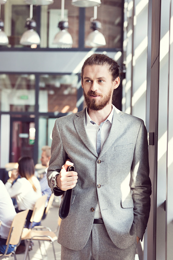 Bearded Businessman Wearing Suit In The Office Stock Photo - Download Image Now