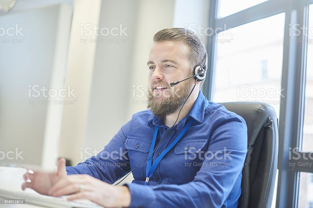 bearded customer service rep stock photo