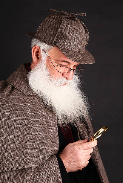 Bearded detective investigate with magnifying glass This bearded detective investigate something with magnifying glass. deerstalker hat stock pictures, royalty-free photos & images