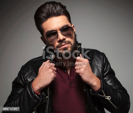 istock bearded fashion man is pulling his jacket's collar 469742937