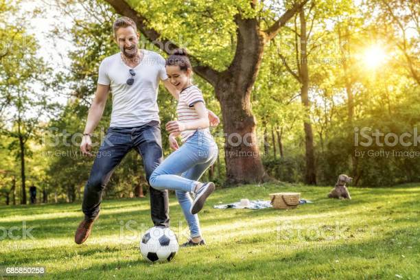 Bearded father and teenage daughter playing soccer on summer meadow picture id685850258?b=1&k=6&m=685850258&s=612x612&h=znkp3ojspfuyreqblrcgs27fph9oyliltolnqbufp m=