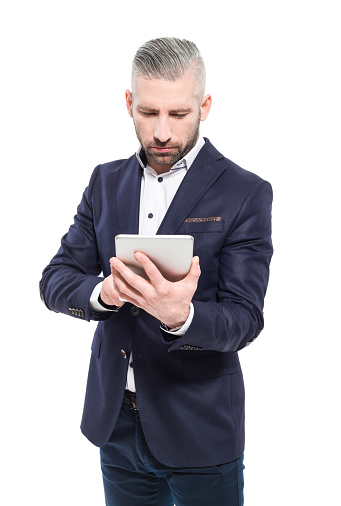 Bearded Grey Hair Businessman Using A Digital Tablet Stock Photo - Download Image Now