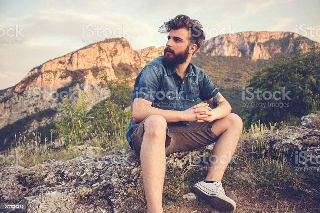Bearded guy freedom in the mountains stock photo