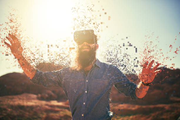 bearded guy in desert wearing vr glasses stock photo