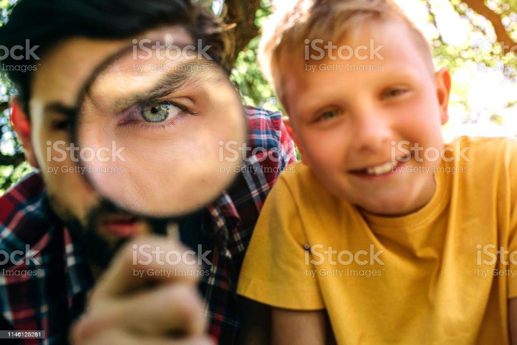 Bearded guy is looking on camera through loop. Oni one eye is zoomed...
