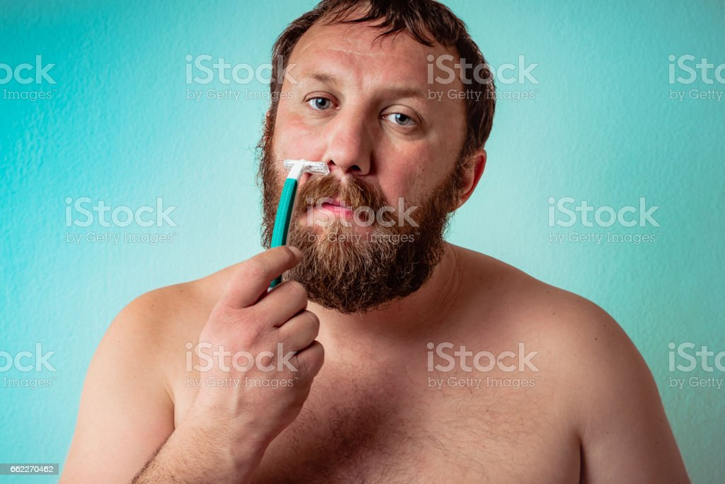 Bearded guy is ready to shave his beard. royalty-free stock photo