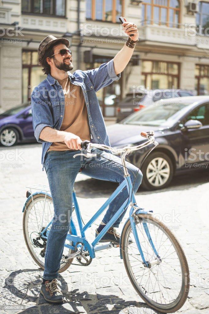 Bearded guy making selfie on his bike - Royalty-free Adult Stock Photo