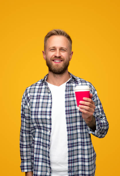 Bearded guy with drink to go stock photo