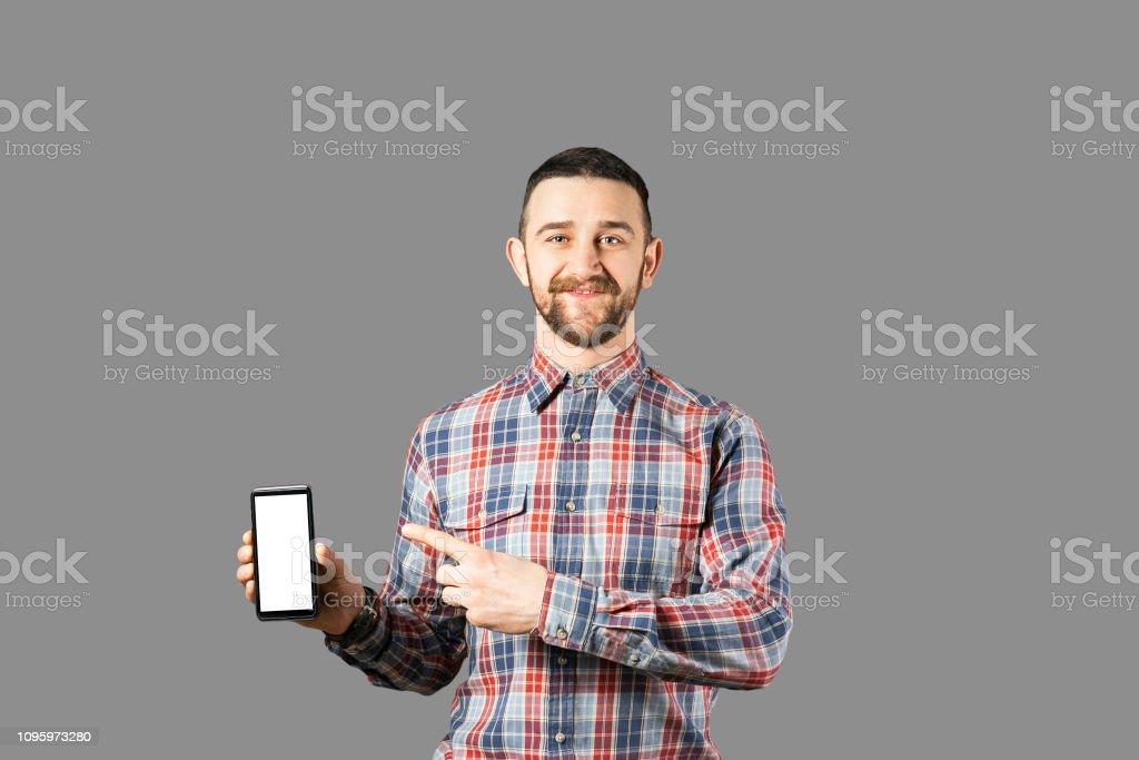 Bearded Hipster Guy Posing Over Grey Background Stock Photo