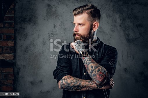 istock Bearded hipster with tattooe on his arms. 918180678