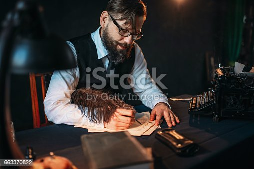 655113470 istock photo Bearded journalistr in glasses writes with feather 663370822
