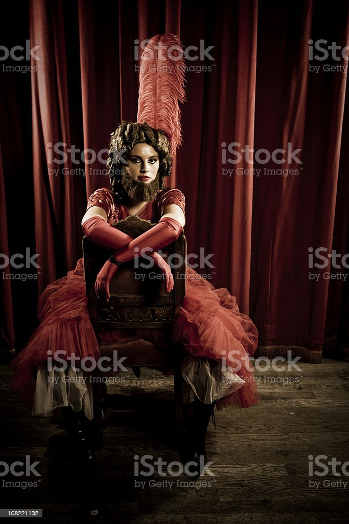Bearded Lady on chair stock photo