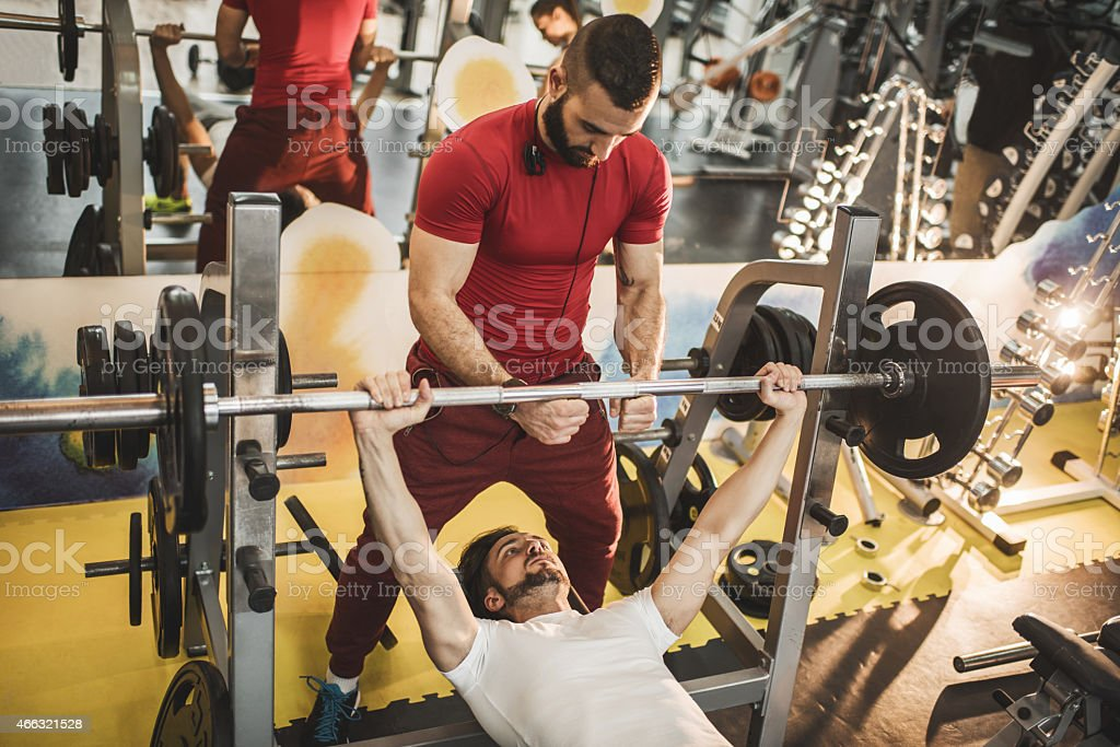 Amazing Bearded Lifter At A Gym With A Spotter Stock Photo
