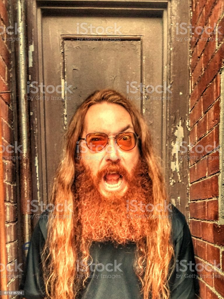 Bearded Long Hair Glasses Heavy Metal Rock Screaming Man Monster stock photo
