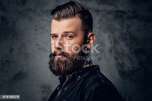 istock Bearded male in black shirt with tattoo on his neck. 918183376