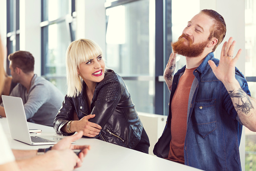 Bearded Man And Blonde Young Woman Working On Laptop Stock Photo - Download Image Now