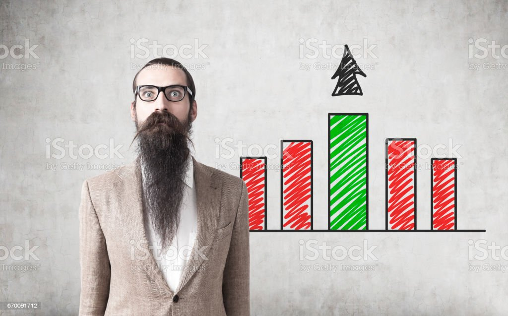 Bearded man and red and green graph stock photo