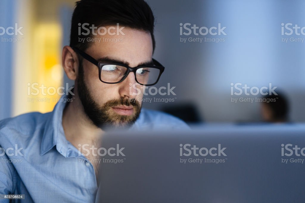Bearded Man Busy Working Late royalty-free stock photo
