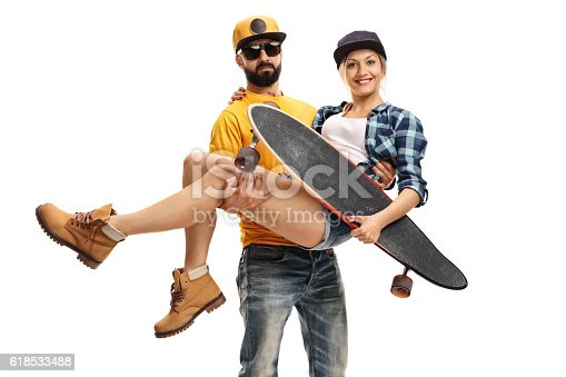 Bearded man carrying a female skater with a longboard in his hands isolated on white background