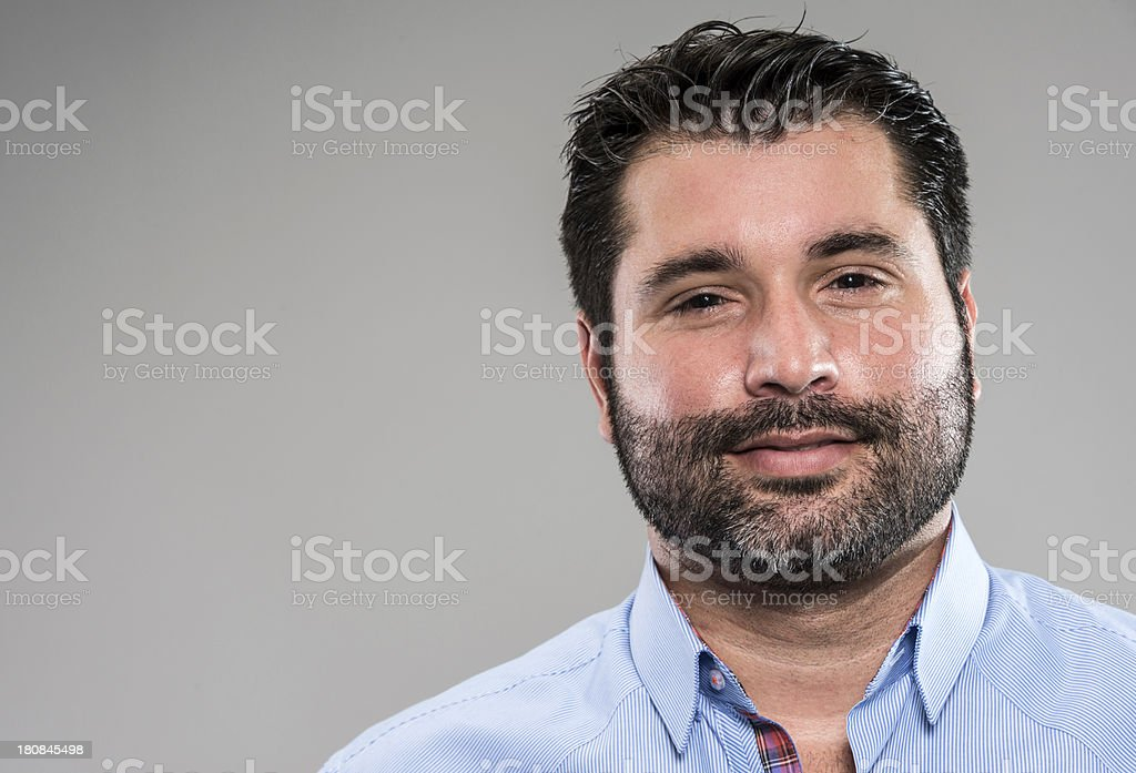 Bearded man in blue button down close-up head shot royalty-free stock photo