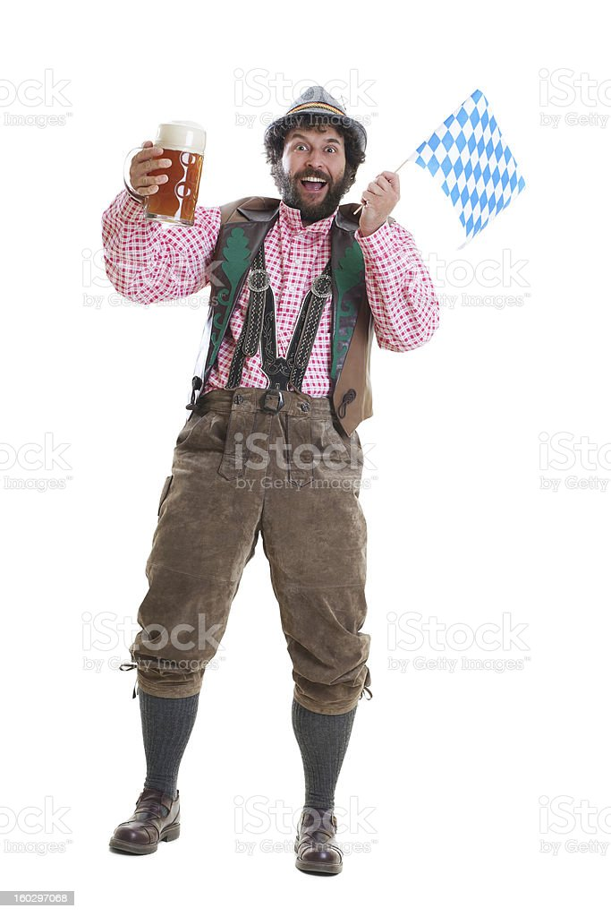 Bearded man in cultural attire with beer and Bavarian flag royalty-free stock photo