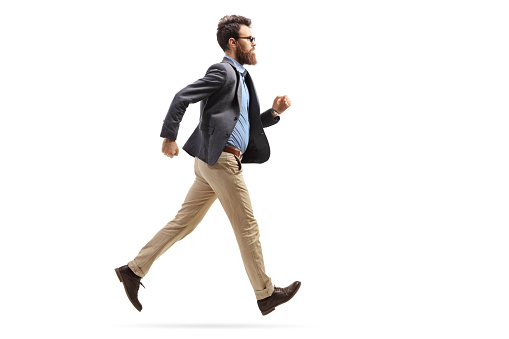 Bearded man in formal clothes running