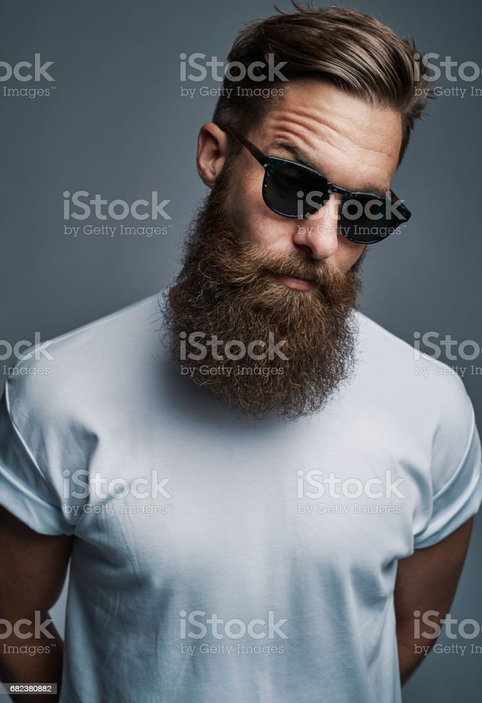 Bearded man in sunglasses with raised eyebrow stock photo
